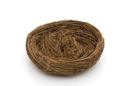 An empty birds nest isolated on white Stock fotó