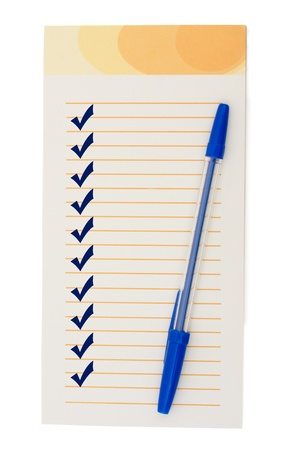 A small notepad with check marks and a pen, Creating a Checklist photo