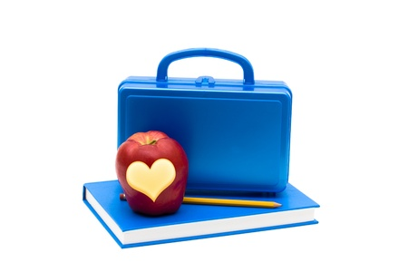 lunch box: Blue lunch box and apple on a blue book isolated on white, School Lunches
