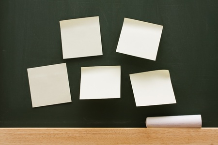 A bunch of sticky notes on a chalkboard with chalk, Schools Notes Stock Photo - 10169941