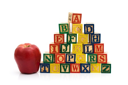 abc blocks: A stack to color wooden blocks of the alphabet with an apple isolated over white, Schools Days