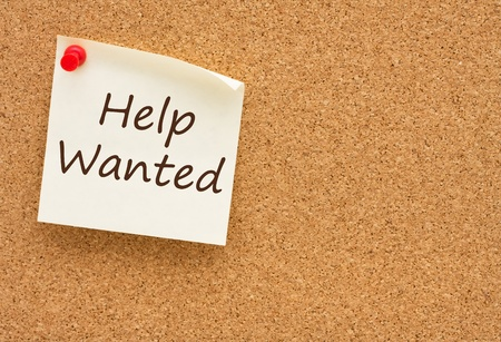 A sticky note on a cork board with the words help wanted on it Stock Photo - 10423767