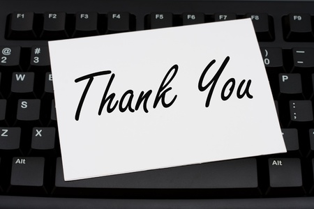Computer keyboard with a thank you card, Thank you for your business photo