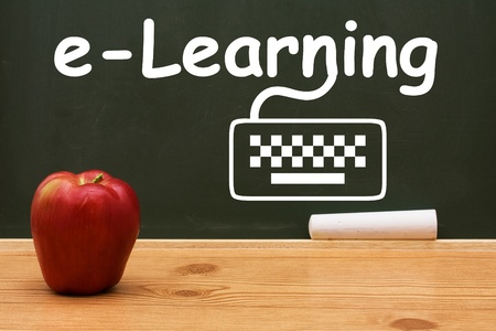 A chalkboard and chalk with text of e-learning and drawing of a computer keyboard, E-learning photo