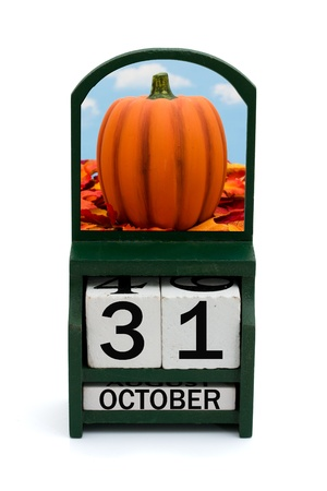 A wooden calendar with a date of October 31 and pumpkin, Happy Halloween photo