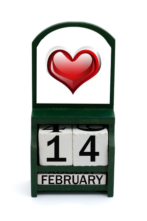 A wooden calendar with a date of February 14 and a heart photo