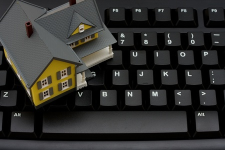 Computer keyboard with a model house, Real estate online