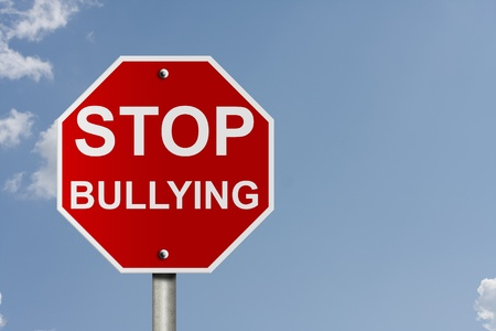 An American road stop sign with sky background and copy space for your message, Stop bullying Stock Photo - 10727628