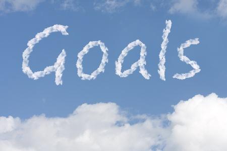 doelen: Het woord doelen geschreven in de blauwe hemel, Het bereiken van uw dromen