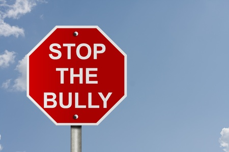 An American road stop sign with sky background and copy space for your message, Stop The Bully Stock Photo - 10834001