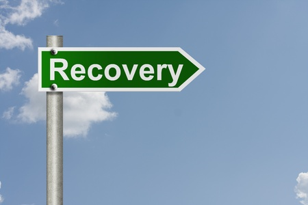road to recovery: An American road sign with sky background and copy space for your message, The way to recovery Stock Photo