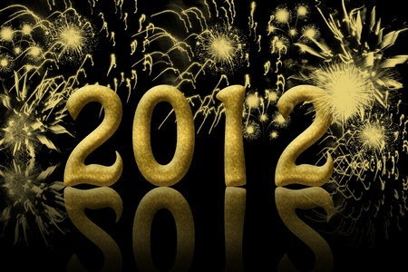 The year 2012 in gold with fireworks in the background Stock Photo - 10927146