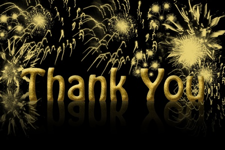 The words thank you in gold with fireworks in the background with copy space photo