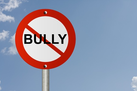 An American road sign and no symbol and word Bully with sky background and copy space for your message, Stop Bully Sign Stock Photo - 11065595