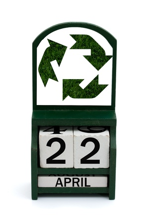 A wooden calendar with a date of April 22 and recycle symbol of grass, Happy Earth Day photo