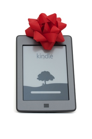 ereader: A kindle touch e-reader with a silver bow isolated on white