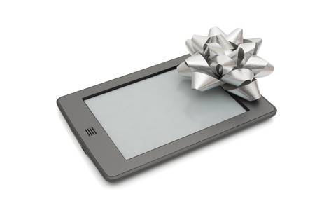A touch e-reader with a silver bow isolated on white photo