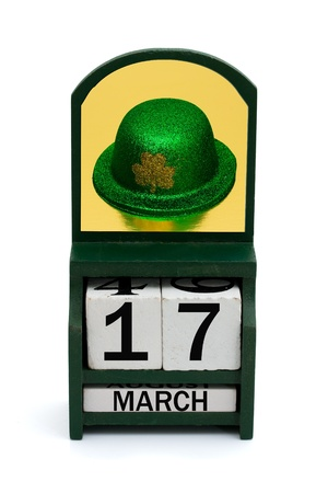 A wooden calendar with a date of March 17 and Irish hat, Happy Saint Patricks Day Stock Photo - 11780102