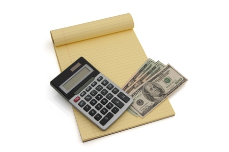 Blank yellow lined notepad with copy-space, calculator and US money, Calculating your money situation photo