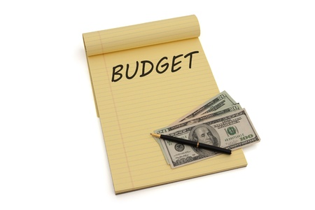Blank yellow lined notepad with copy-space and US money, Budgeting your money photo