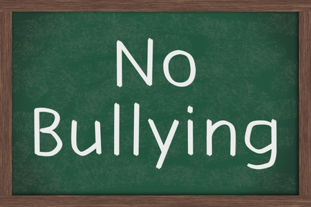 A chalkboard  with the chalk letters no bullying Stock Photo - 11976498
