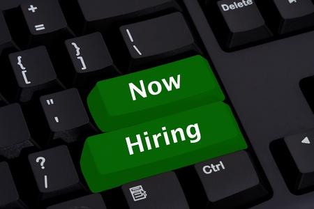 technology career: Computer keyboard key displaying word now hiring, Now Hiring Stock Photo