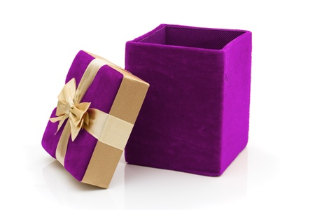 A purple velvet present opened with a gold bow isolated on white, Happy Holidays photo