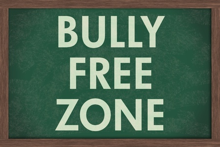 A chalkboard  with the chalk letters bully free zone, Bully Free Zone at schools photo