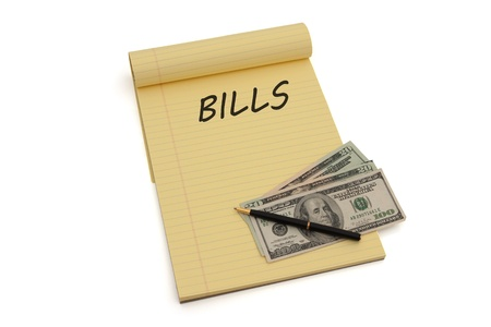 Blank yellow lined notepad with copy-space and US money, Planning to pay your bills photo