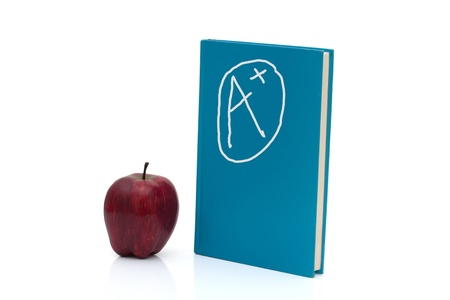 A blue book standing up with an apple and A plus sign isolated on a white background, Excellence in education