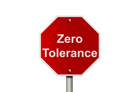 tolerance: An American road stop sign isolated on white with words zero tolerance