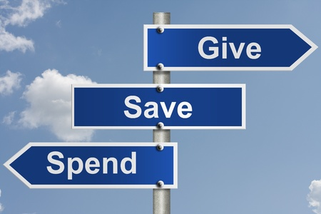 spent: American road signs with the sky with words give, save and spend, Where you money is spent Stock Photo
