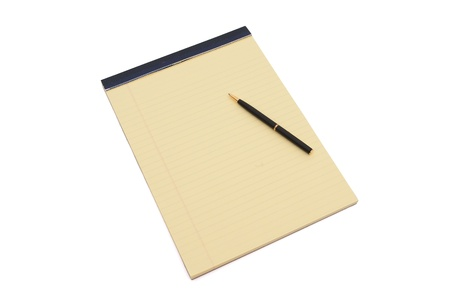 Blank yellow lined notepad with copy-space and a pen, work in progress photo
