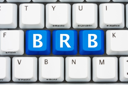 slang: A computer keyboard with blue keys spelling BRB, Be Right Back