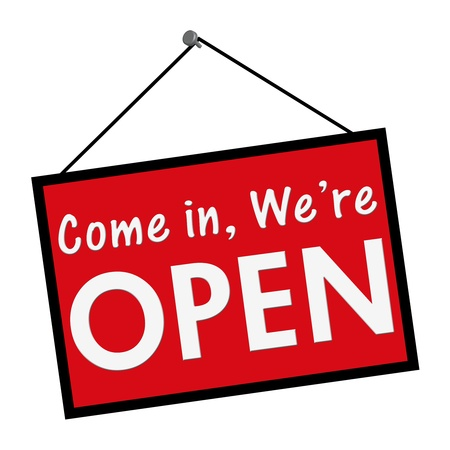 A red, white and black sign with the words come in we are open isolated on a white background photo