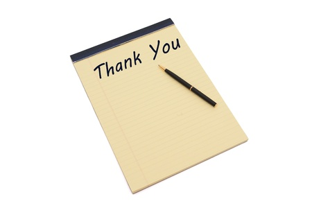 Blank yellow lined notepad with copy-space and a pen, Writing a thank you note photo
