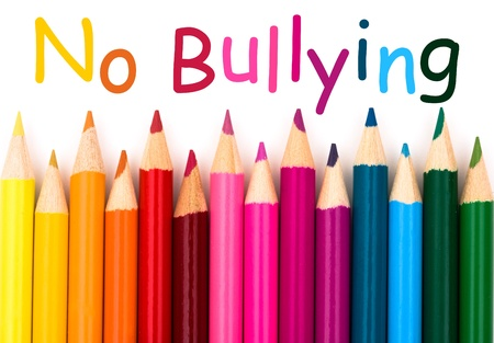 A pencil crayon border isolated on white background with words No Bullying Stock Photo