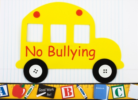A school bus on lined paper with words no bullying, No bullying allowed  photo