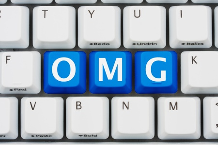 A computer keyboard with blue keys spelling OMG, Internet slang Stock Photo