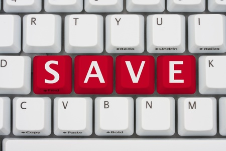 A computer keyboard with red keys spelling save, Save by shopping on the internet