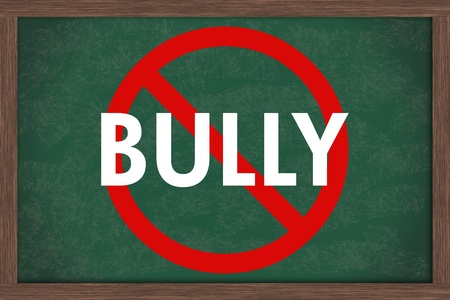 bully: A chalkboard  with the chalk letters bully and a red no symbol, No bullying at schools