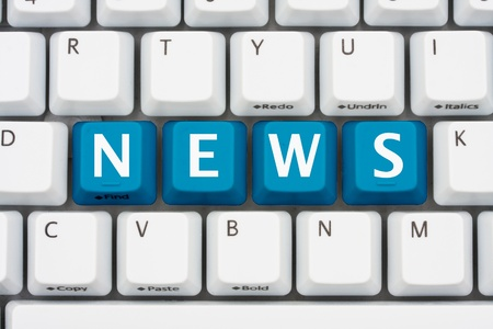 news current events: A computer keyboard with blue keys spelling news, Getting your news on the internet Stock Photo