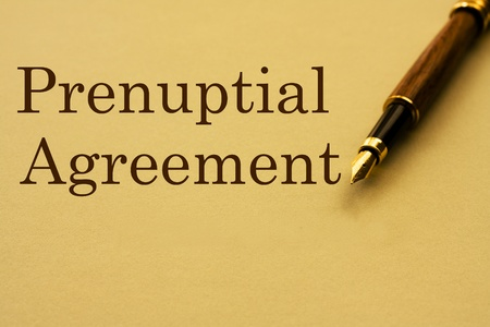 A fountain pen with yellow paper with  word prenuptial agreement and copy-space, Getting a prenuptial agreement