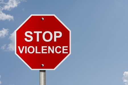 An American road stop sign with clouds with words stop violence, Stopping Violence Stock Photo - 12922458