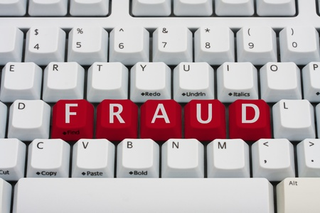 web scam: A computer keyboard with red keys spelling fraud, Internet Fraud