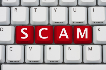 A computer keyboard with red keys spelling scam, Internet Scams Stock Photo - 12922471