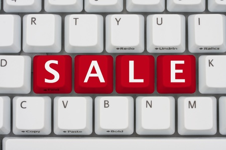 A computer keyboard with red keys spelling Sale, Online Sale