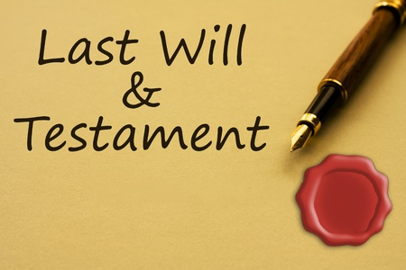 A fountain pen with yellow paper with a wax seal and words last will and testament and copy-space, Getting a last will and testament