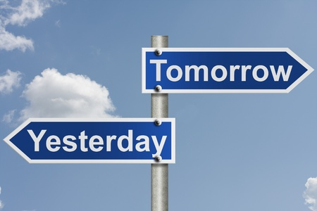 yesterday: An American road sign with sky background and Yesterday and Tomorrow signs,Timing