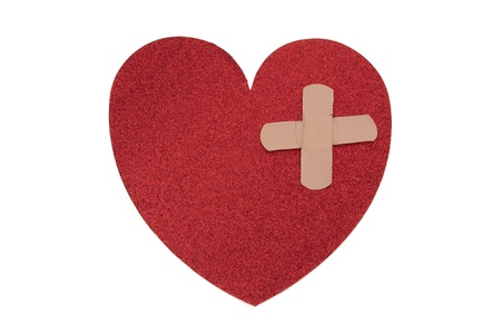 bandaid: Large red heart with two bandages with copy-space isolated on white, Fixing a broken heart Stock Photo